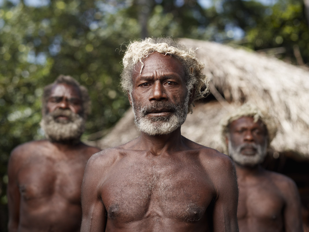 """Certain men are given the responsibility to keep the rest of the village in good spirits, taking on the title of """"Happy Man,"""" Yakel, Tanna Island, Vanuatu"""