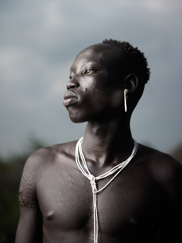 The Mursi are considered some of the most feared warriors in the Omo Valley. (Ongoing series 2008 - 2013)