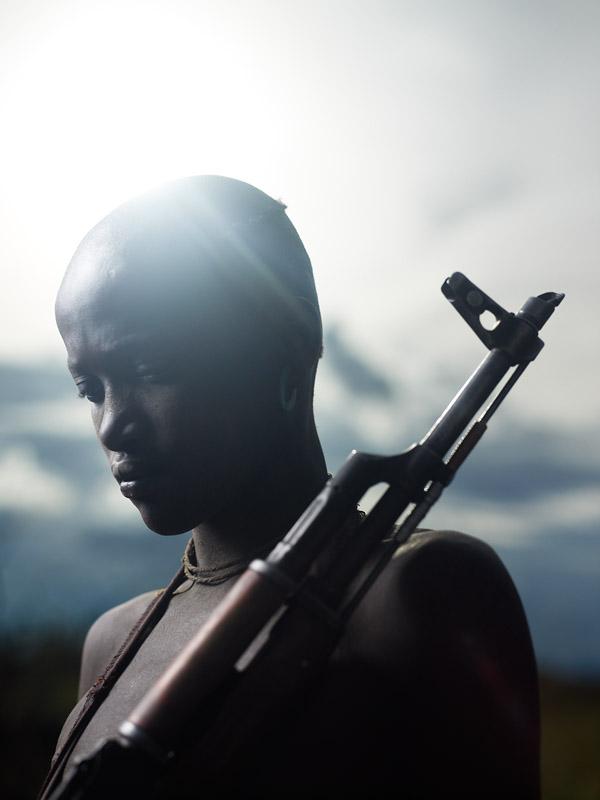 Olochia shot an invading Hyena near their home with their family's Kalashnikov rifle.
