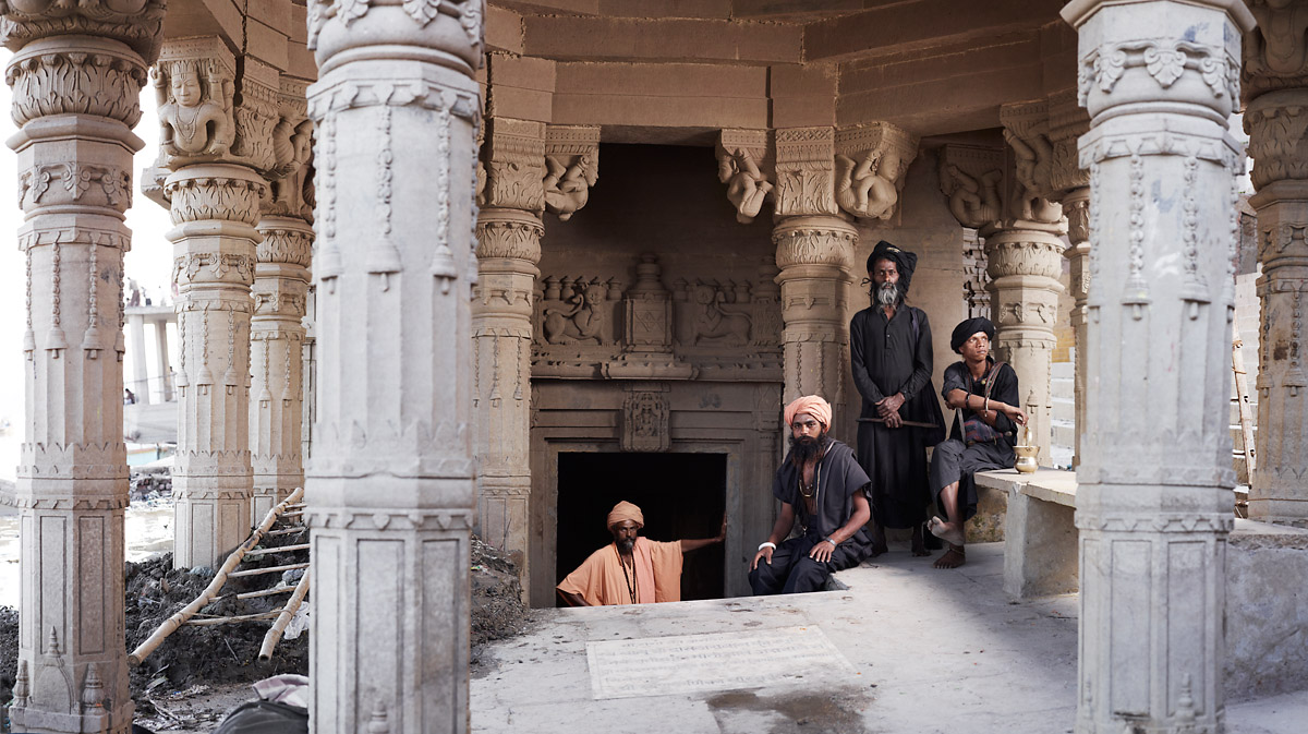 Aghori sadhus inside a sunken Shiva temple at Scindia Ghat, on the banks of the River Ganges. Varanasi, India