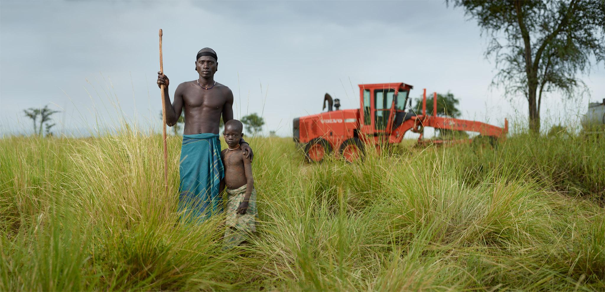 Geri Botulu and Ganggang Geri with bulldozer. Bodi Me'en Tribe, Lower Omo Valley, Ethiopia