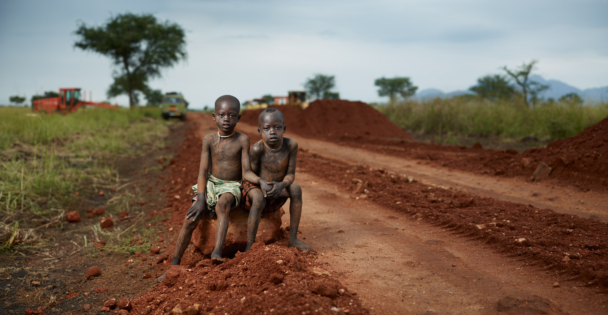 Ganggang and Arbodgi with road construction. Bodi Me'en Tribe, Lower Omo Valley, Ethiopia