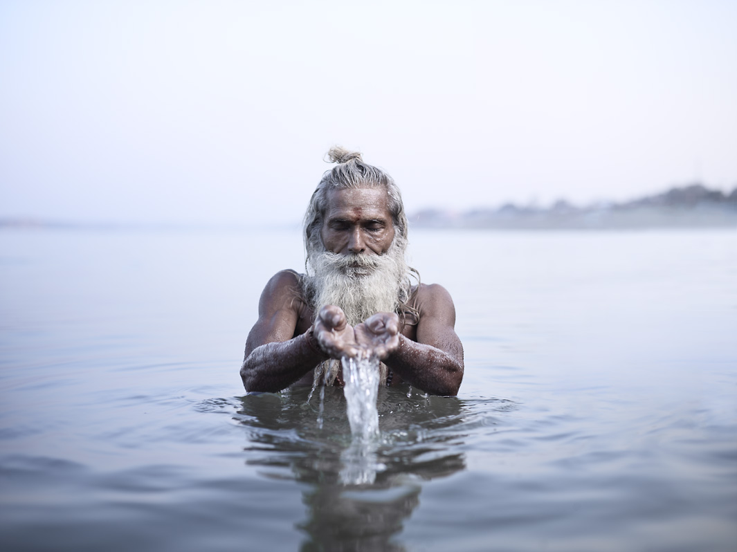 Vijay Nund performing morning rituals in the Ganges River, the most sacred river in Hinduism.  Varanasi, India